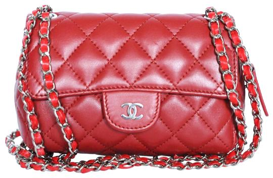 Preload https://img-static.tradesy.com/item/25282241/chanel-classic-flap-mini-quilted-mirror-red-lambskin-leather-cross-body-bag-0-1-540-540.jpg