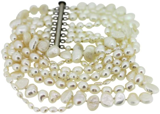 Preload https://img-static.tradesy.com/item/25282452/cream-colored-pearlssterling-silver-clasp-8-strand-2-inches-wide-long-bracelet-0-1-540-540.jpg