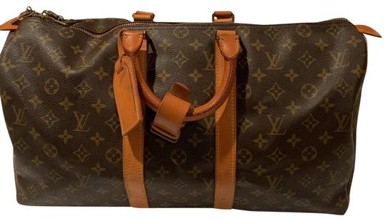 Preload https://img-static.tradesy.com/item/25285361/louis-vuitton-speedy-45-brown-monogram-canvas-with-textile-lining-and-gold-tone-brass-hardware-weeke-0-1-540-540.jpg