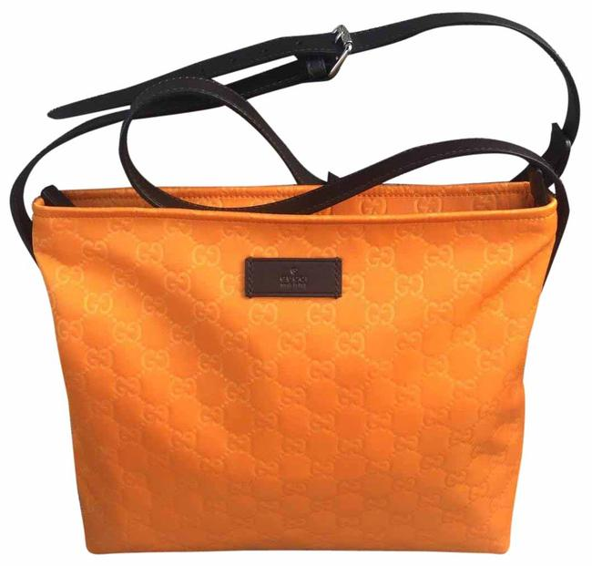 Item - Shoulder Messenger Gg Embossed ssima /Cross Tangerine Nylon Cross Body Bag