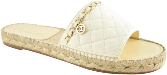 Preload https://img-static.tradesy.com/item/25293009/chanel-ivory-18p-quilted-gold-chain-cc-logo-espadrille-slide-sandal-mule-flats-size-eu-40-approx-us-0-1-540-540.jpg