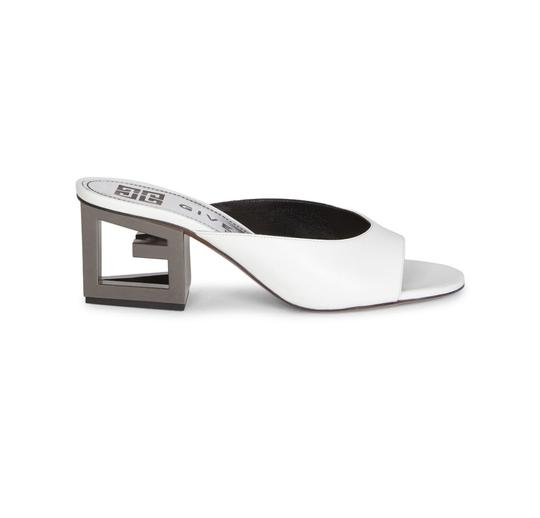 Preload https://img-static.tradesy.com/item/25293413/givenchy-ivory-white-patent-leather-triangle-75-mulesslides-size-eu-375-approx-us-75-regular-m-b-0-0-540-540.jpg