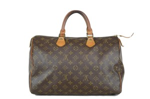 Louis Vuitton Speedy Leather Tote in Brown
