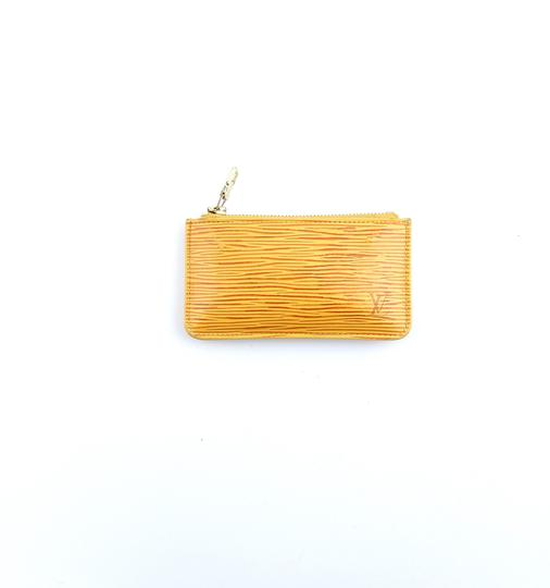 Preload https://img-static.tradesy.com/item/25293591/louis-vuitton-yellow-pochette-cles-epi-coated-leather-credit-coin-purse-keychain-wallet-0-0-540-540.jpg