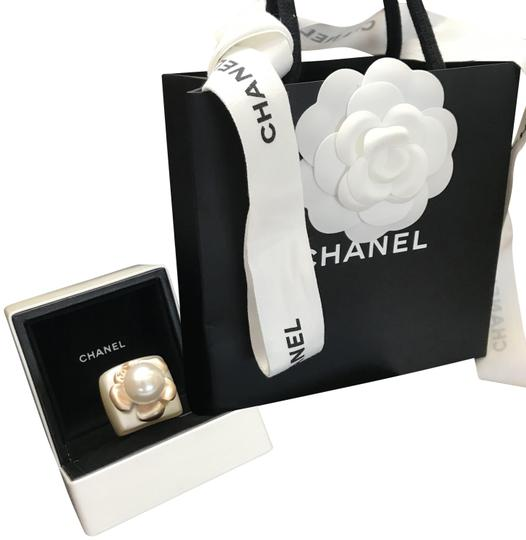 Preload https://img-static.tradesy.com/item/25300473/chanel-gold-shimmer-nwot-champagne-camellia-pearl-resin-ring-0-1-540-540.jpg