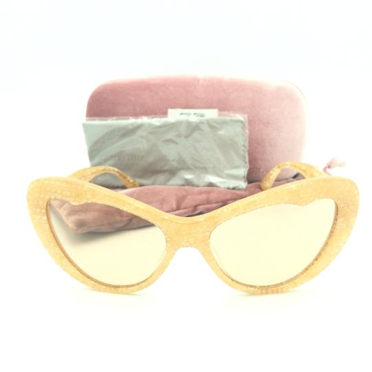 Preload https://img-static.tradesy.com/item/25300688/miu-miu-translucent-tan-kaleidoscope-cat-smu-04o-sunglasses-0-0-540-540.jpg