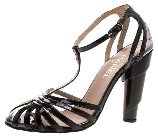 Preload https://img-static.tradesy.com/item/25305129/chanel-black-patent-leather-and-pvc-architectural-t-strap-sandals-size-eu-375-approx-us-75-regular-m-0-1-540-540.jpg