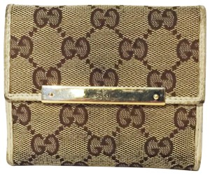 fb2af5c8a86b Gucci Gucci brown monogram white leather trim snap button wallet
