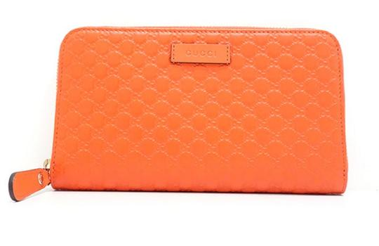 Preload https://img-static.tradesy.com/item/25308382/gucci-orange-leather-microguccissima-gg-zip-around-449391-wallet-0-0-540-540.jpg