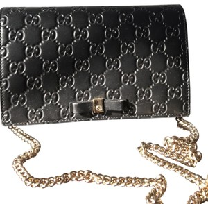 bed29db3640 Gucci Cross Body Bag · Gucci. Signature Mini Wallet On Chain with Bow  Leather ...