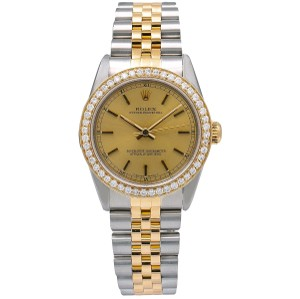 Rolex Rolex Oyster Perpetual 67513 31MM Champagne Dial With 1.05 CT Diamonds