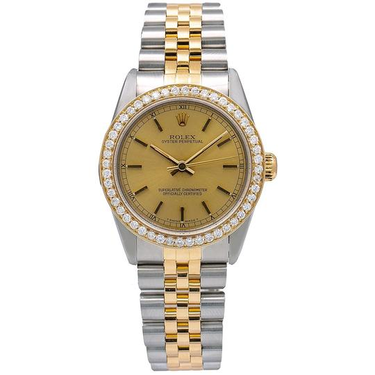 Preload https://img-static.tradesy.com/item/25317914/rolex-champagne-oyster-perpetual-67513-31mm-dial-with-105-ct-diamonds-watch-0-0-540-540.jpg