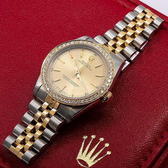 Rolex Rolex Oyster Perpetual 67513 31MM Champagne Dial With 1.05 CT Diamonds Image 1