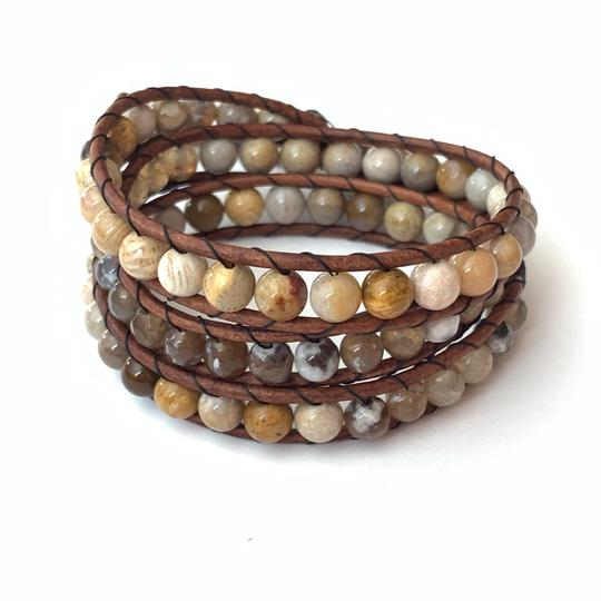 Preload https://img-static.tradesy.com/item/25322059/tan-leather-beige-gemstones-flower-bomb-bracelet-0-0-540-540.jpg