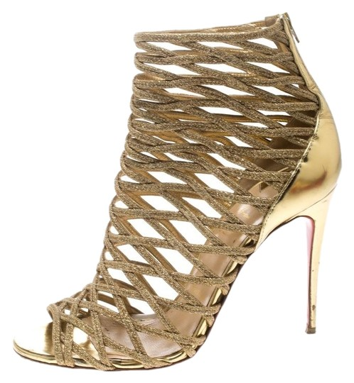Preload https://img-static.tradesy.com/item/25329317/christian-louboutin-gold-glitter-and-leather-gladiator-caged-bootsbooties-size-eu-385-approx-us-85-r-0-1-540-540.jpg