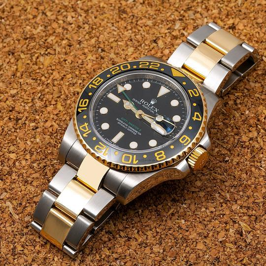 Rolex Rolex GMT-Master II 116713 40MM Black Dial With Two Tone Jubilee Image 1