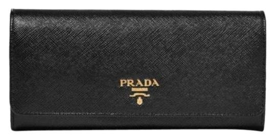Preload https://img-static.tradesy.com/item/25329941/prada-saffiano-leather-flap-continental-long-wallet-0-1-540-540.jpg