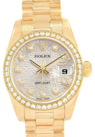 Preload https://img-static.tradesy.com/item/25330031/rolex-silver-president-26mm-yellow-gold-diamond-ladies-179138-box-paper-watch-0-1-540-540.jpg