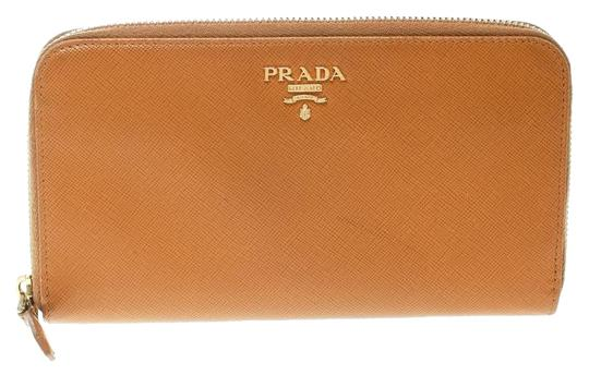 Preload https://img-static.tradesy.com/item/25332800/prada-yellow-mustard-saffiano-metal-leather-zip-around-wallet-0-1-540-540.jpg