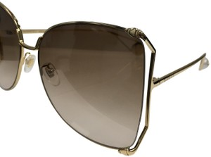78acec064e9 Gucci Gucci Women s Sensual Romantic GG 0252S Fashion Butterfly Sunglasses