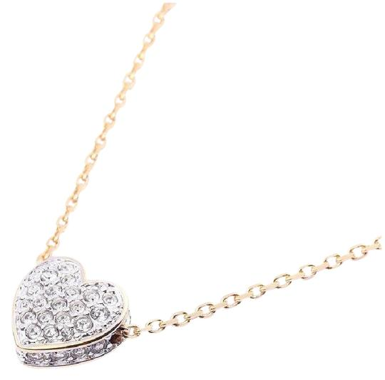 Preload https://img-static.tradesy.com/item/25342445/swarovski-clear-crystal-and-gold-heart-pendant-plated-necklace-0-1-540-540.jpg