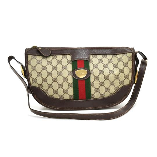 Preload https://img-static.tradesy.com/item/25346142/gucci-vintage-monogram-pochette-brown-canvas-clutch-0-0-540-540.jpg