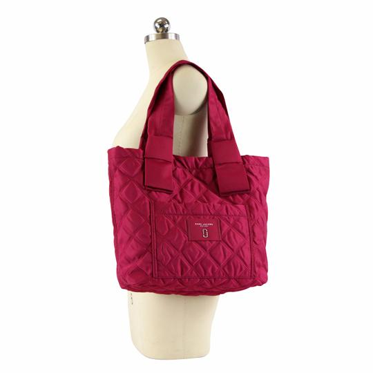 Preload https://img-static.tradesy.com/item/25349833/marc-jacobs-quilted-knot-rasberry-nylon-tote-0-1-540-540.jpg