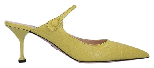 Preload https://img-static.tradesy.com/item/25355419/prada-yellow-crocodile-embossed-leather-mulesslides-size-eu-37-approx-us-7-regular-m-b-0-1-540-540.jpg