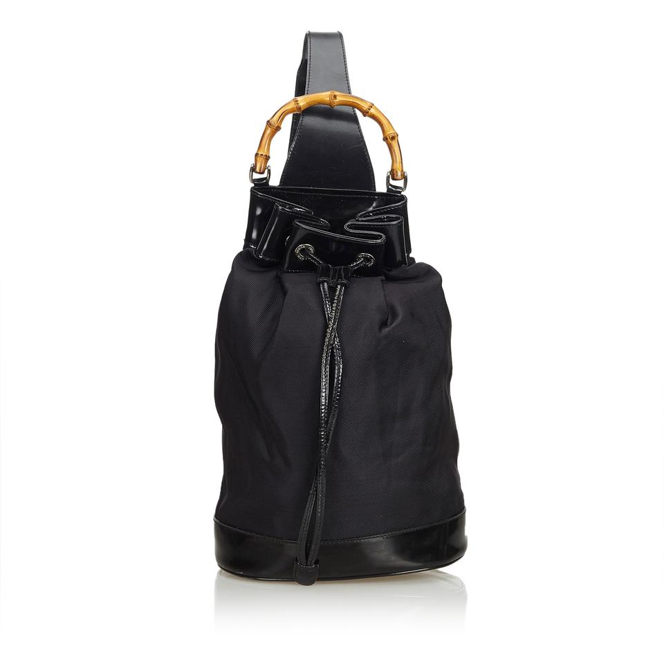 ec57dd8e1102 Gucci Drawstring Bamboo Italy Medium Black Canvas Leather Backpack ...