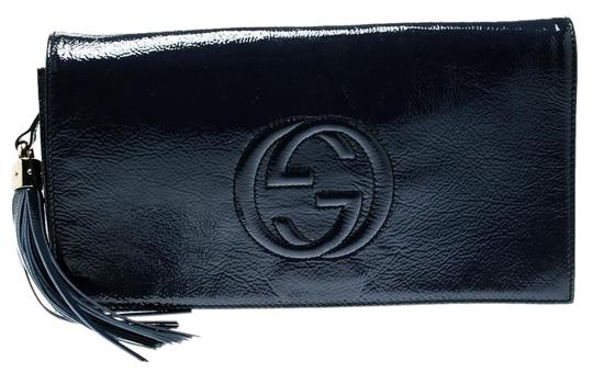 Preload https://img-static.tradesy.com/item/25366026/gucci-soho-navy-blue-leather-clutch-0-1-540-540.jpg
