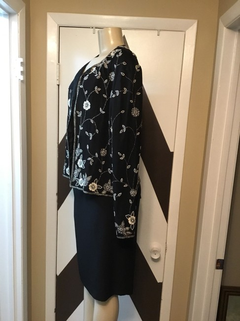 Adrianna Papell NWOT ADRIANNA PAPELL BOUTIQUE evening set. Mother of the bride, church, evening occasions, wedding? You can go wrong with this amazing 100% silk ornate top and gorgeous skirt ensemble. Please be advise that the top is large and the text is 18. Image 1