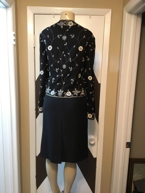 Adrianna Papell NWOT ADRIANNA PAPELL BOUTIQUE evening set. Mother of the bride, church, evening occasions, wedding? You can go wrong with this amazing 100% silk ornate top and gorgeous skirt ensemble. Please be advise that the top is large and the text is 18. Image 7