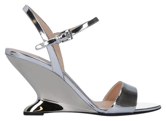 Preload https://img-static.tradesy.com/item/25368315/prada-silver-laminated-wedge-leather-sandals-size-eu-38-approx-us-8-regular-m-b-0-1-540-540.jpg