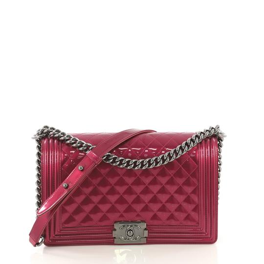 Preload https://img-static.tradesy.com/item/25373491/chanel-classic-flap-boy-quilted-patent-new-medium-pink-leather-cross-body-bag-0-0-540-540.jpg
