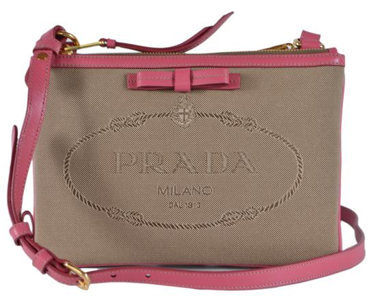 Preload https://img-static.tradesy.com/item/25374548/prada-double-new-1bh046-logo-bandoliera-zip-pink-and-brown-jacquard-leather-cross-body-bag-0-0-540-540.jpg