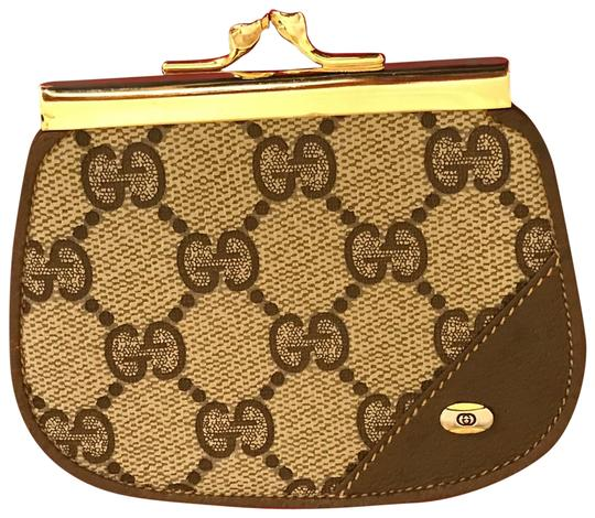 Preload https://img-static.tradesy.com/item/25374887/gucci-brown-kiss-lock-coin-purse-wallet-0-1-540-540.jpg