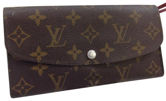 Preload https://img-static.tradesy.com/item/25374964/louis-vuitton-portefeuille-emilie-m60136-monogram-bifold-wallet-brown-clutch-0-1-540-540.jpg