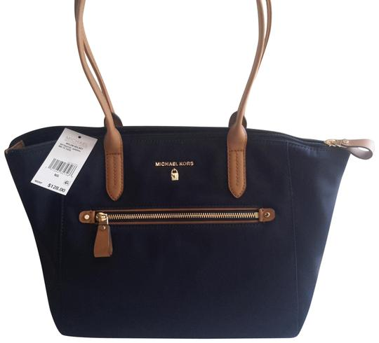 Preload https://img-static.tradesy.com/item/25375059/michael-kors-kelsey-navybrown-nylon-tote-0-1-540-540.jpg