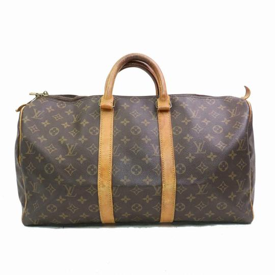 Preload https://img-static.tradesy.com/item/25375431/louis-vuitton-keepall-45-m41428-monogram-11274-brown-cotton-canvas-weekendtravel-bag-0-0-540-540.jpg