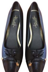 Hush Puppies black with Gold accent on tie Pumps
