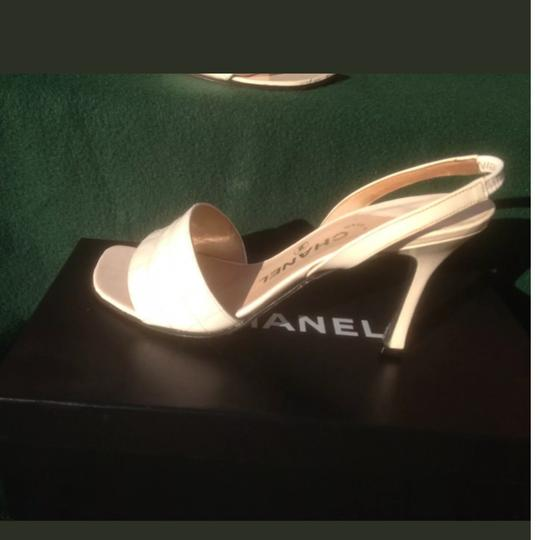 Preload https://item3.tradesy.com/images/chanel-white-patent-leather-37-sandals-size-us-7-regular-m-b-25377402-0-2.jpg?width=440&height=440