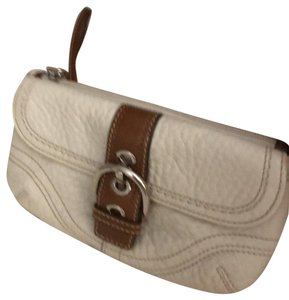 Coach Wristlet in off white. tans leather trim
