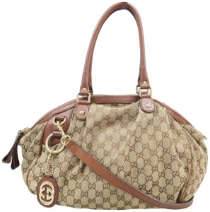 45a8db9f6194 Added to Shopping Bag. Gucci Sukey Medium Canvas Satchel in Brown and tan