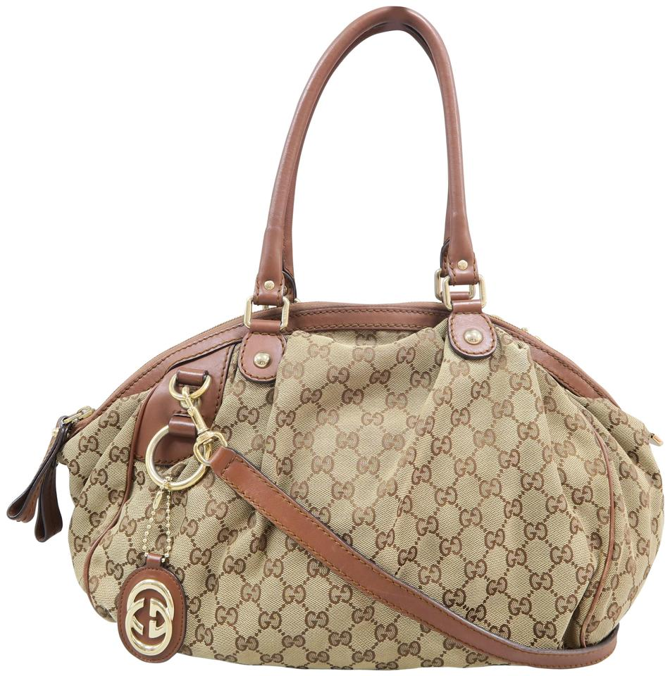 f703a42cd7881a Gucci Sukey Medium Canvas Satchel in Brown and tan Image 0 ...