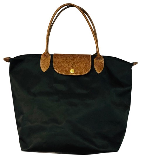 Preload https://img-static.tradesy.com/item/25388848/longchamp-brown-leather-trim-black-nylon-tote-0-2-540-540.jpg