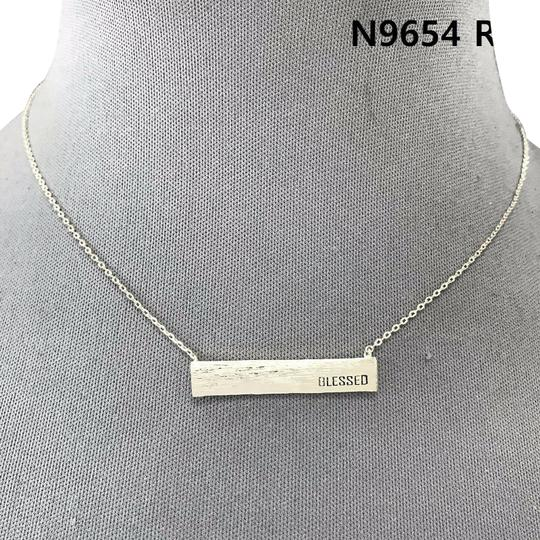 Preload https://img-static.tradesy.com/item/25404038/silver-finish-blessed-engraved-pendant-necklace-0-1-540-540.jpg
