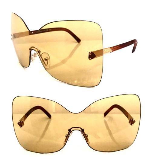 Preload https://img-static.tradesy.com/item/25404616/fendi-yellow-havana-over-sized-rimless-shield-sunglasses-0-0-540-540.jpg