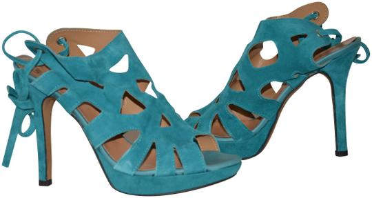Preload https://img-static.tradesy.com/item/25411807/un-deux-trois-blue-teal-tight-on-platform-398-85-new-sandals-size-eu-39-approx-us-9-regular-m-b-0-1-540-540.jpg