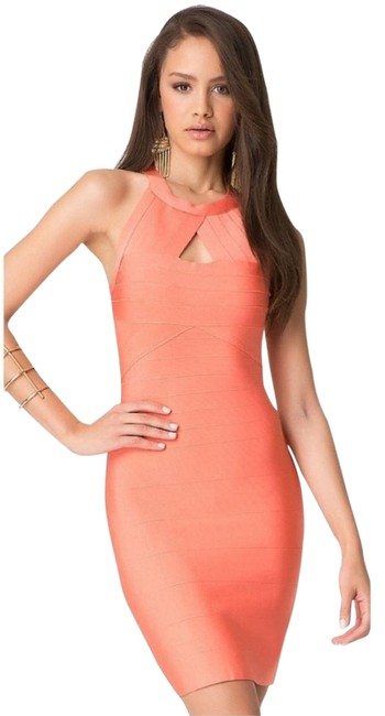 Preload https://img-static.tradesy.com/item/25412397/bebe-salmon-orange-peekaboo-bandage-mid-length-cocktail-dress-size-4-s-0-1-650-650.jpg