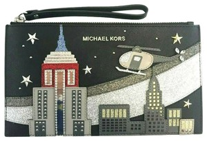 ecaf87c2cc07ed Michael Kors Clutches - Up to 70% off at Tradesy